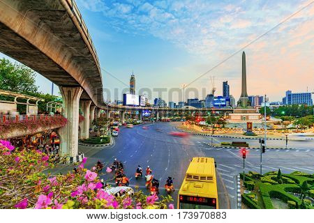 BANGKOK THAILAND - FEBRUARY 02: This is a view of Victory monument roundabout with a skytrain overpass February 02 2017 in Bangkok