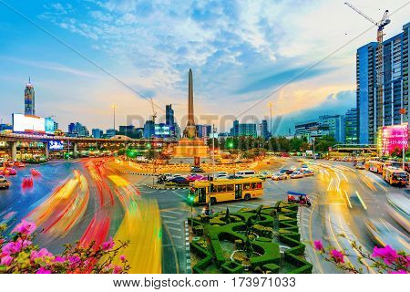 BANGKOK THAILAND - FEBRUARY 02: This is a view of Victory Monument in the evening where many buses cars and vans come to drop off passengers February 02 2017 in Bangkok