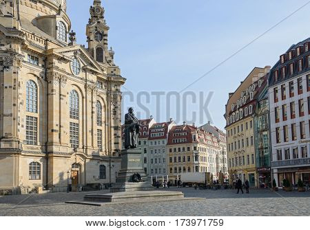 DRESDEN, GERMANY - FEBRUARY 22: People are walking on Neumarkt Square near Frauenkirche (Church of Our Lady) and Martin Luther monument on February 22, 2015 in Dresden, Saxony, Germany.