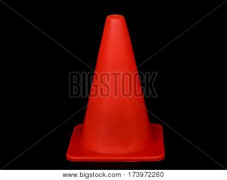 close up of traffic cone on black background