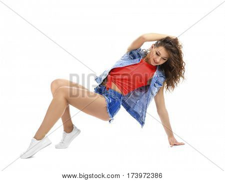Beautiful young hip-hop dancer on white background