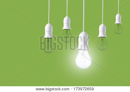 difference light bulb on green background. concept of new ideas with innovation and creativity.