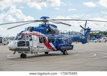 Aberdeen, Scotland - August 30 2015: Heicopter waiting for the pilot at the Bristow Heliport