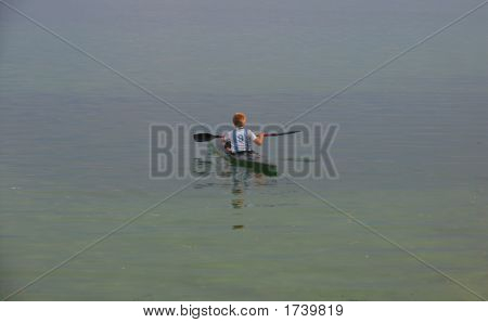 picture of a canoe with boy on ohrid lake in macedonia poster