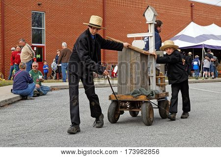 STRASBURG PENNSYLVANIA - February 25 2017: Amish boys deliver items for buyers at the annual spring auction