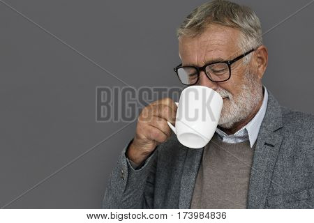 Caucasian Old Mature Drinking Coffee