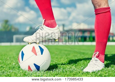 Soccer kick-off ball with French flags, toned image, horizontal image, selective focus