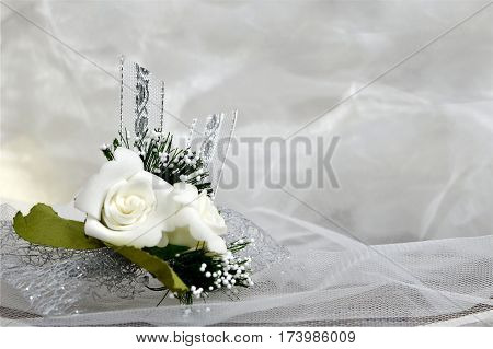 Wedding decoration: Boutonniere flowers on tulle background