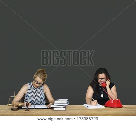 Two Ladies Working Law Firm