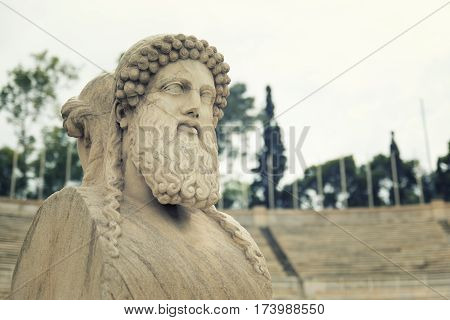 ATHENS, GREECE, SEPTEMBER 8,2016: Close up shot to the head section of Herm statue at Panathenaic Stadium, Athens, Greece.