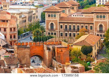 View from the observation deck Mirador de la Lona of the old town, Triumphal Square and the city gate Puerta de Elvira, Granada, Andalusia, Spain