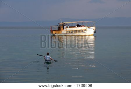 picture of boat sceneru boat and canoe with boy on ohrid lake in macedonia poster