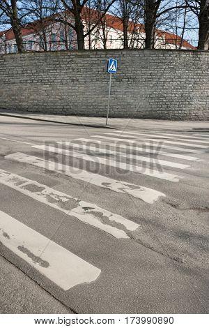 Pedestrian crossing sign on empty street; Tallinn; Estonia; Europe