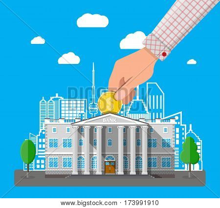 Depositing money in bank account. Hand putting coin into bank building. Road, trees, cityscape, clouds. Vector illustration in flat style