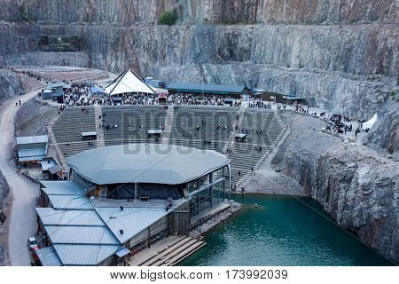 Concert arena in old disused open-pit. Dalhalla, Rattvik, Sweden - September 04, 2010: View over Dalhalla concert arena in old disused open-pit used for mining. Evening, people waiting for concert.