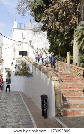 MARBELLA, SPAIN - FEBRUARY 27, 2017: People going down by stairs in the historic center of Marbella Andalusia Spain.