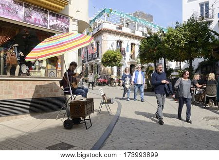 MARBELLA, SPAIN - FEBRUARY 27, 2017: Man Playing the guitar in a street of the historic center of Marbella Andalusia spain