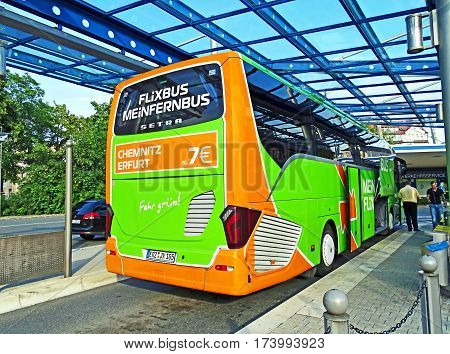 Chemnitz, Germany - July 24, 2015: A luxury long-distance coach of the company MeinFernbus FlixBus is ready for departure to Dresden at the bus station in Chemnitz.