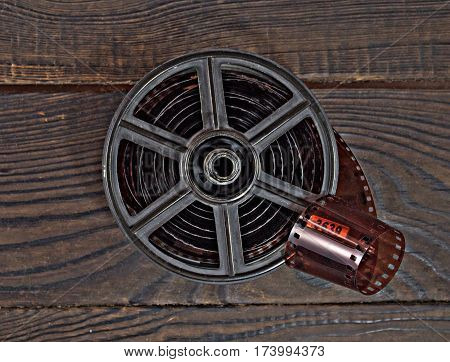 Equipment for film development on the dark wooden surface. Retro. Top view