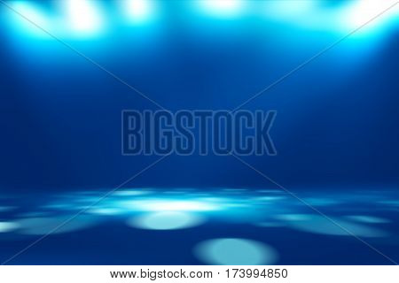 soft blue studio room background, grey floor backdrop with spotlight