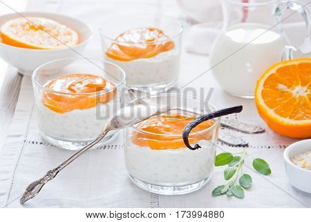 Rice pudding with vanilla and orange custard