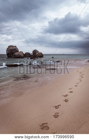 Footprints on the beach on the ocean coast