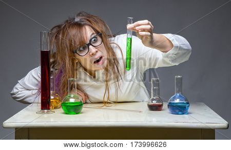 Mistake and messy scientist in lab on gray background