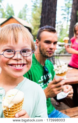 Cute Little Boy With Downs Syndrome Holding an Ice Cream Cone