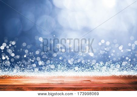 empty wooden on blue lighting backdrop. christmas light background
