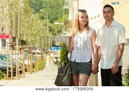 Happy Couple Walking In City Enjoying Romance
