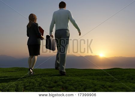 People walk on the green grass.