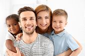 Happy interracial family at home poster