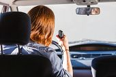 Talking while drive auto walkie talkie comunication concept. Young man driving car using cb radio poster
