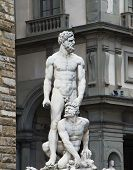 travel to Italy - statue Hercules and Cacus on Piazza della Signoria in Florence city. This work by the Florentine artist Baccio Bandinelli (1525-1534) poster