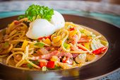 """""""Kee mao"""" Spaghetti thai style spaghetti with boiled egg on the top. poster"""