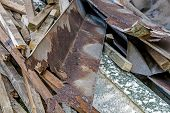 Close up of builders rubble after roof repaires stacked and ready for collection and removal poster