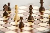 black and white chess figures on chessboard, chess game poster