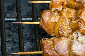A Pork Skewer Stick On The Grill