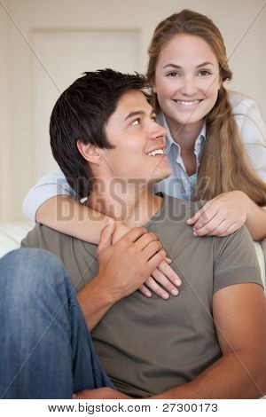 Portrait of a couple embracing each other in their living room