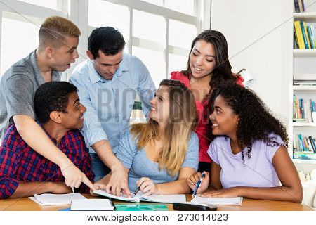 German Female Student With Group Of International Students An Teacher Indoor At Classroom Of Univers