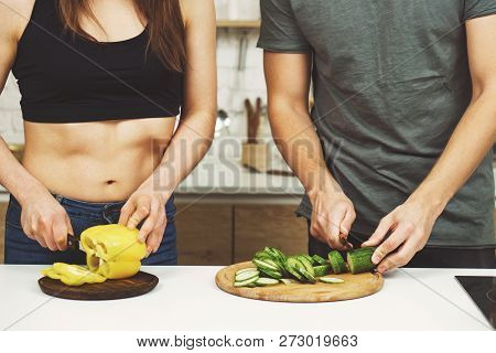 Healthy Lifestyle, Dieting, Proper Nutrition, Vegetarian Food, Paleo Diet. Sporty Couple Cooking Din