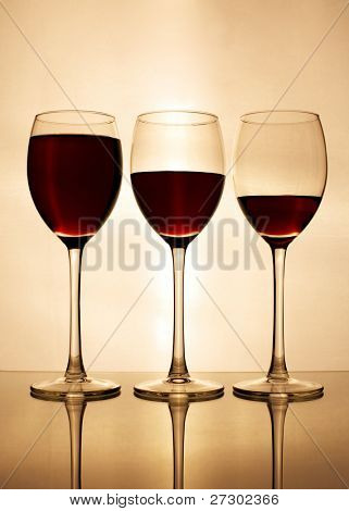 three glasses of red wine