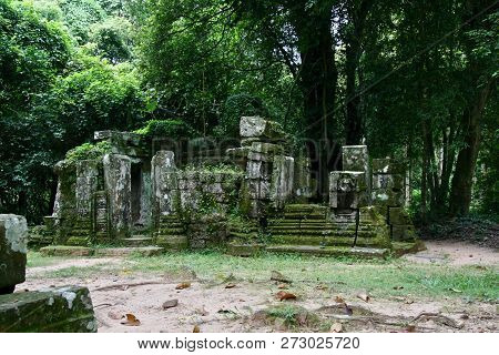 Old Stone Moss Covered Ruins In A Clearing The Jungles Of Cambodia