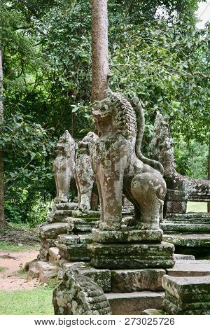 Carved Stone Moss And Lichen Covered Lion Statues In The Jungles Of Asia