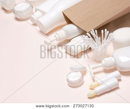 Cosmetic Products With Kraft Paper Merchandise Bag. Selective Focus, Copy Space