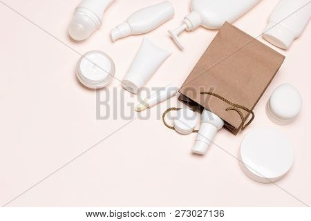 Different Skincare Products With Paper Merchandise Bag. Buying Cosmetics, Beauty Shopping Background