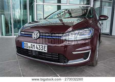 Dresden, Germany - April 2 2018: Plug-in Hybrid Volkswagen E-golf Electric Car Stands In Front Of Th