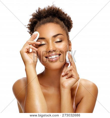 Sensual Beautiful Woman Cleaning Her Face With Cotton Pads. Photo Of Smiling African American Woman
