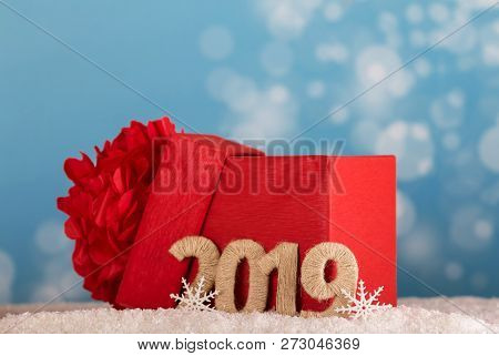 Big Red Box With A Bow For Gifts And The Inscription 2019 New Year A Snow Background