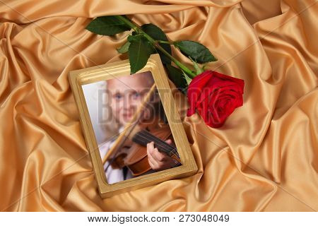 Gold Frame For A Photo And Rose On The Background Of Beautiful Pleated Satin Fabric